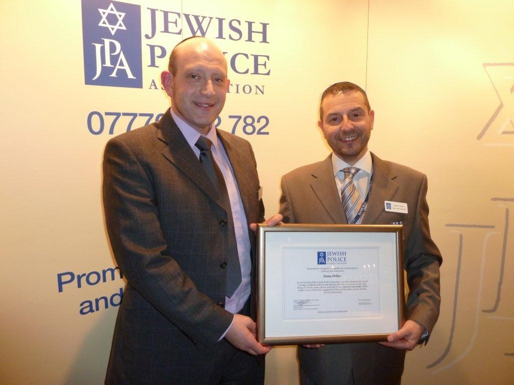 JPA Chair, Mathew Shaer presents certificate of recognition to JPA Co-founder, Danny Phillips