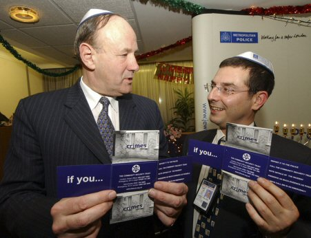 Blue lines: Metropolitan Police Commissioner Sir John Stevens, with PC Danny Phillips