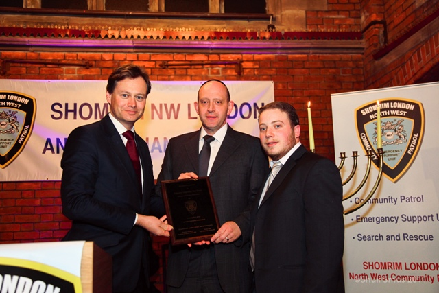 Hendon MP, Matthew Offord, presents JPA Chair, Mathew Shaer, with his award together with Gavriel Ost, Chief Executive of Shomrim NW.